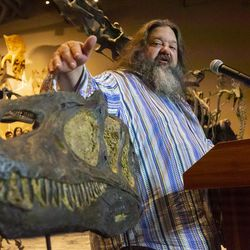 Mark Loewen, research associate at the Natural History Museum of Utah and associate professor in the Department of Geology and Geophysics at the University of Utah, describes a few of the features of Allosaurus jimmadseni, a new species of meat-eating dinosaur, during its unveiling at the museum in Salt Lake City on Friday, Jan. 24, 2020. The beast inhabited the flood plains of western North America 157 million years ago, making it the geologically oldest species of allosaurus.