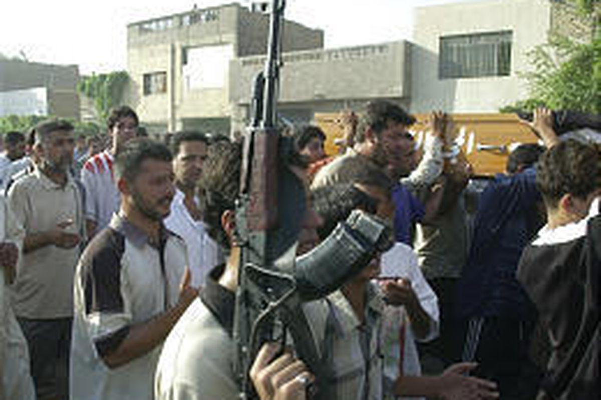 Supporters of rebel Shiite cleric Muqtada al-Sadr carry a coffin in Sadr City, a Baghdad slum, Friday after a U.S. air raid.