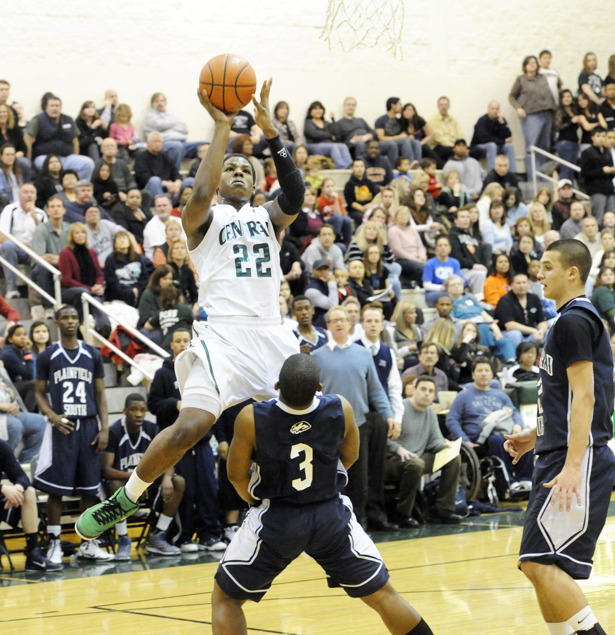 Plainfield Central's Derrick Marks drives to the basket around Plainfield South's Zach Singrabe.