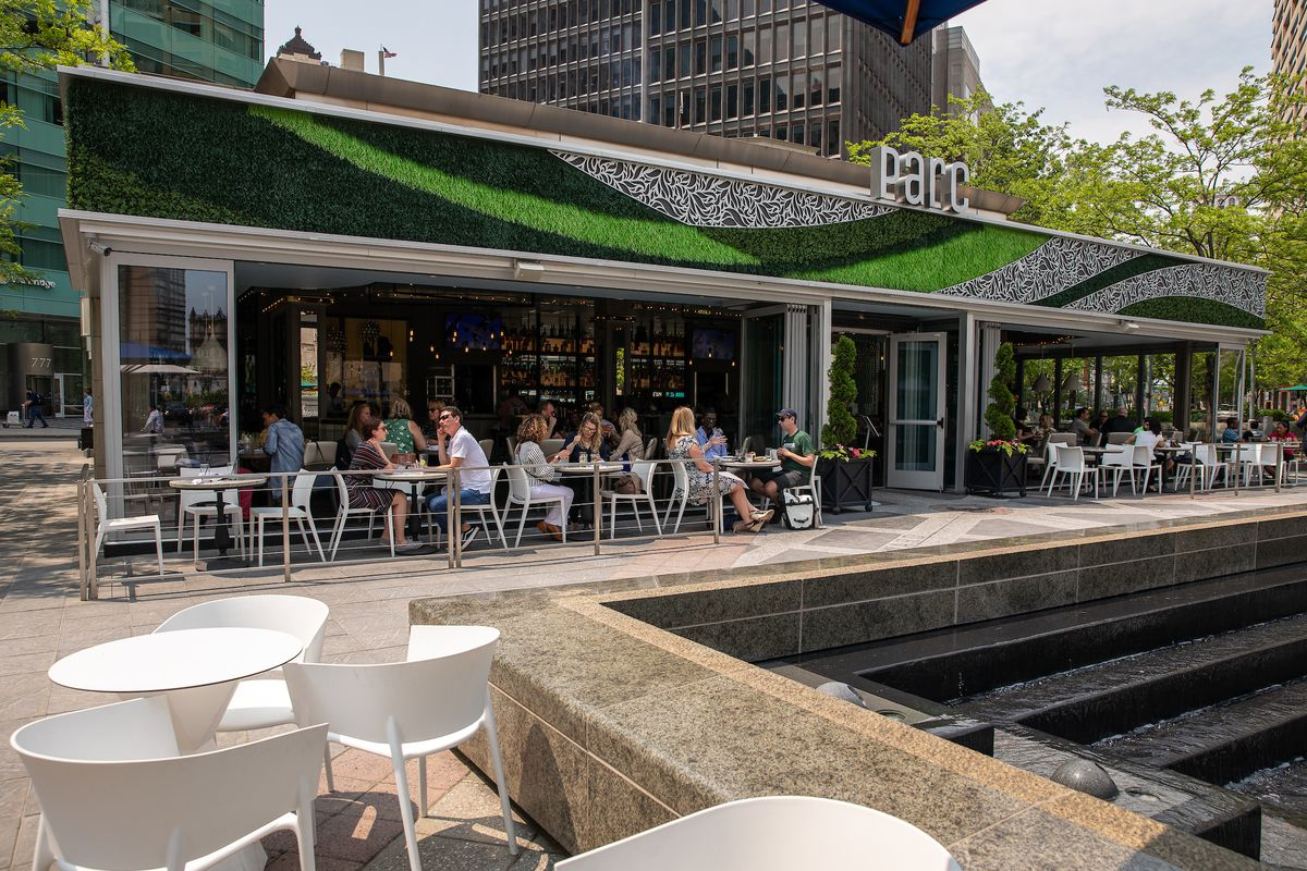 customers sit at tables at parc in Campus Martius.