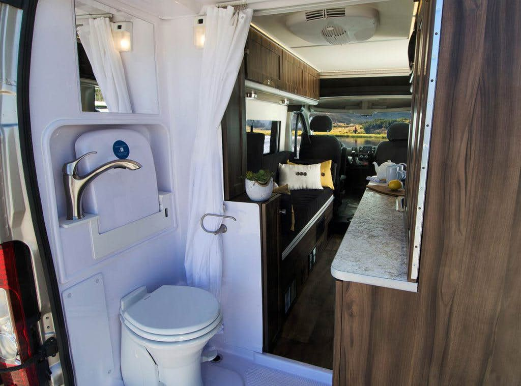 Compact camper van fits a bathroom sleeps two curbed - Class a motorhomes with rear bathroom ...