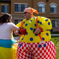 Keith Hall and Holly Smith, volunteers with Bristol Hospice Utah, dance in inflatable costumes outside The Ridge Cottonwood, an assisted living facility in Holladay, on Saturday, April 18, 2020.