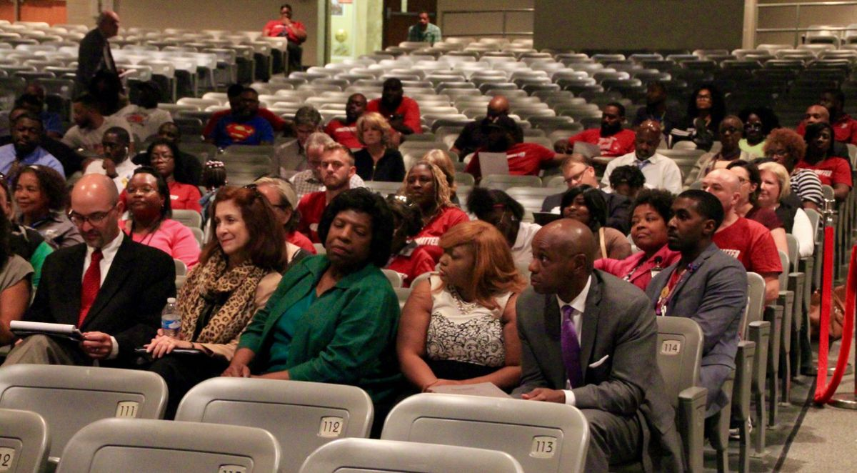 Superintendent Dorsey Hopson and several staff members sit with school board Chairwoman Teresa Jones during the meeting.