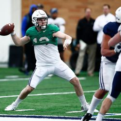 BYU quarterback Tanner Mangum looks to pass during the Cougars' practice in the Indoor Practice Facility on Thursday, March 15, 2018, in Provo.