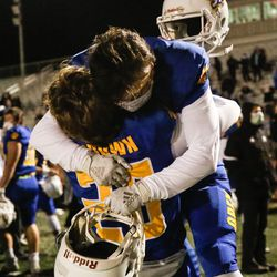 Orem's Kade Brown hugs Brayden Theurer (11) after a high school 5A state semifinal football game at Cedar Valley High School in Eagle Mountain on Friday, Nov. 13, 2020.