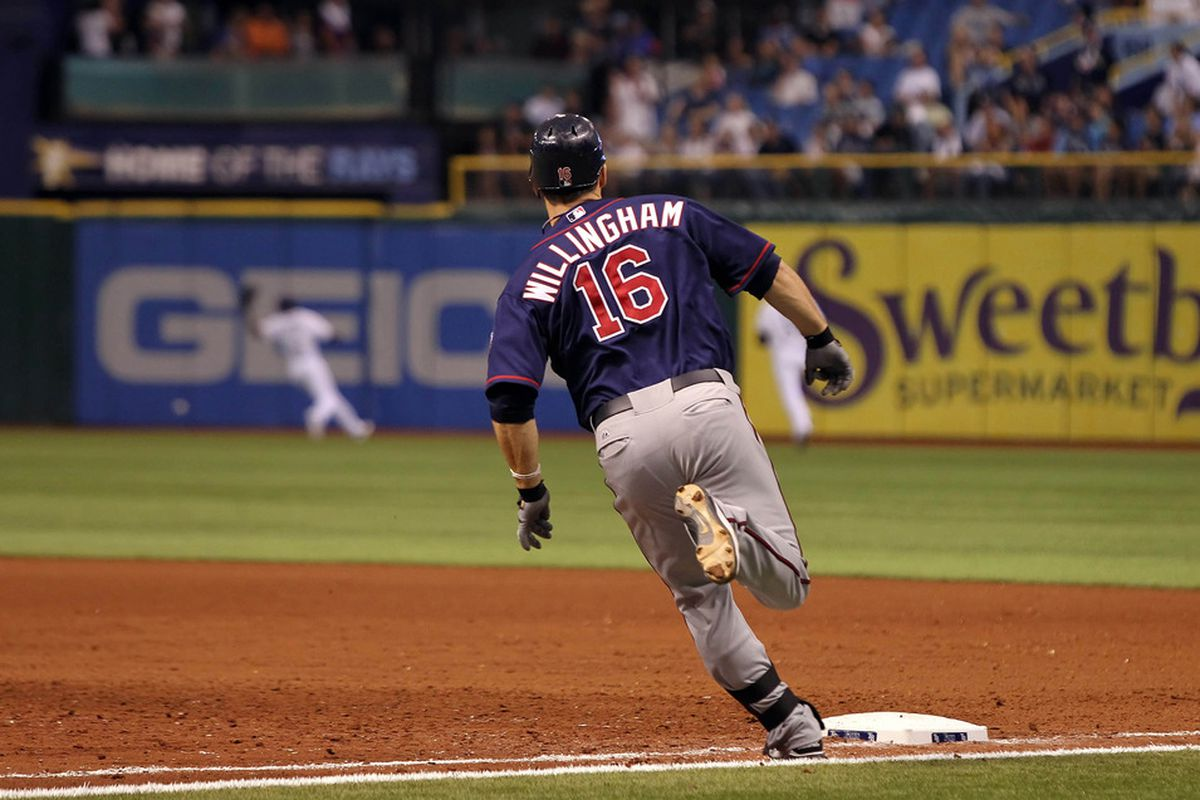April 20, 2012; St. Petersburg, FL, USA; Minnesota Twins left fielder Josh Willingham (16) hits a 3-RBI double in the seventh inning against the Tampa Bay Rays at Tropicana Field. Mandatory Credit: Kim Klement-US PRESSWIRE