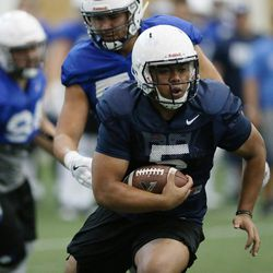 Brigham Young Cougars RB Ula Tolutau (5) runs during BYU football alumni day practice in Provo on Friday, March 31, 2017.