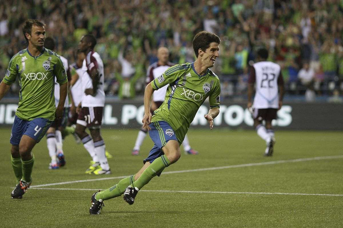 SEATTLE, WA - JULY 07:  Alvaro Fernandez #15 of the Seattle Sounders celebrates after scoring a goal against the Colorado Rapids at CenturyLink Field on July 7, 2012 in Seattle, Washington. (Photo by Otto Greule Jr/Getty Images)