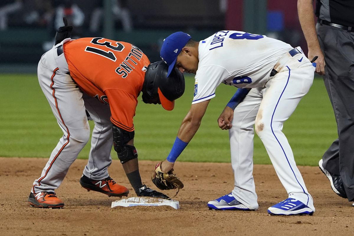 Cedric Mullins #31 of the Baltimore Orioles slides into second for a double past the tag of Nicky Lopez #8 of the Kansas City Royals in the eighth inning at Kauffman Stadium on July 17, 2021 in Kansas City, Missouri.