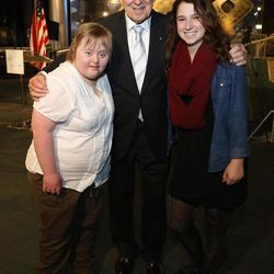 """Captain James A. Lovell, Jr, center, poses for a picture with Anne Wagner, left, and her friend Mary Doro, right, during 45th Anniversary of Apollo 8 """"Christmas Eve Broadcast to Earth"""" event at the Museum of Science and Industry Features in Chicago, Monday, Dec. 23, 2013."""