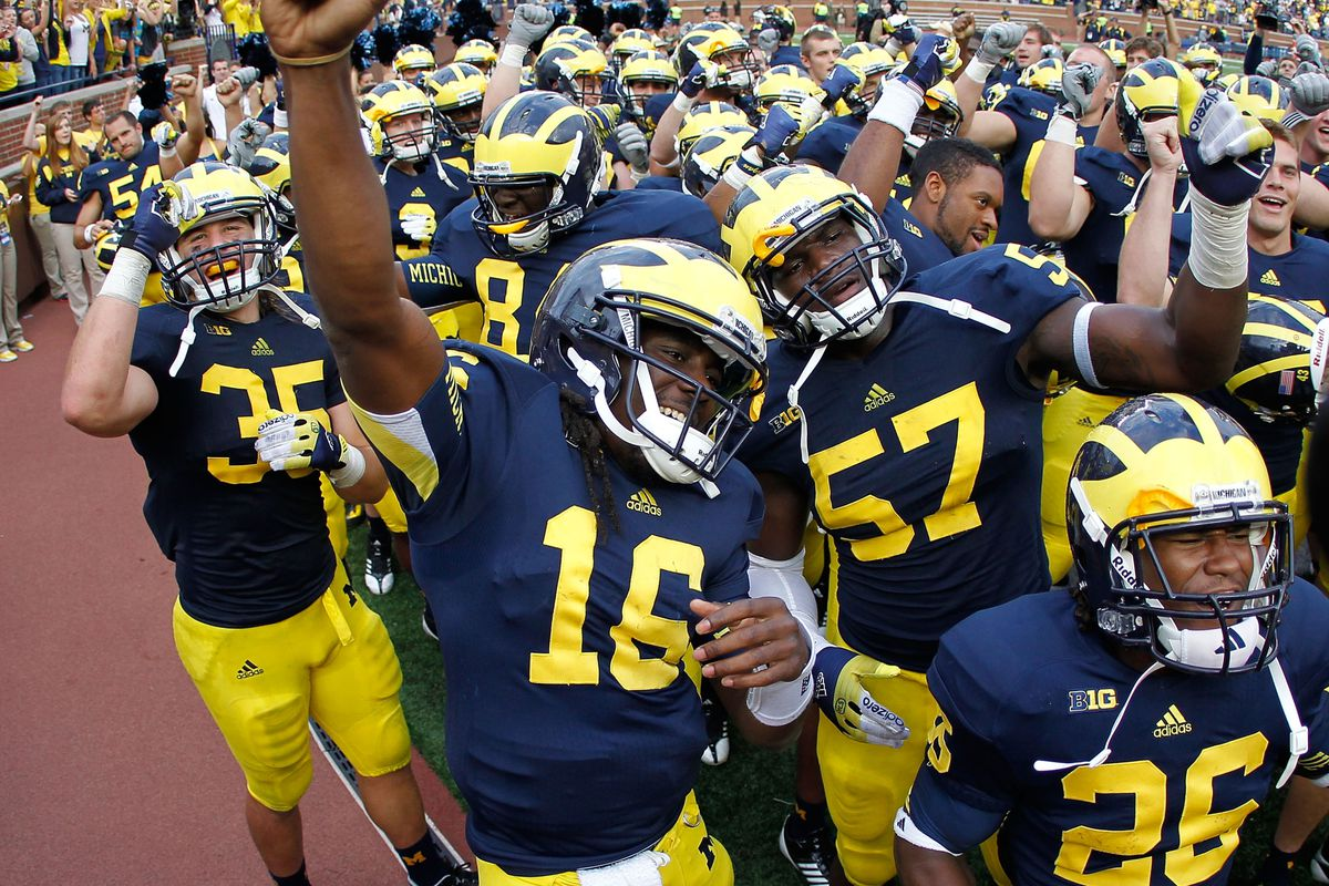 ANN ARBOR, MI - SEPTEMBER 08:  Denard Robinson #16 of the Michigan Wolverines celebrates a 31-25 win over the Air Force Falcons with his teammates at Michigan Stadium on September 8, 2012 in Ann Arbor, Michigan. (Photo by Gregory Shamus/Getty Images)