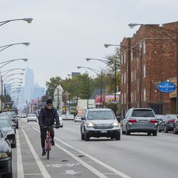 A cyclist rides down North Elston Avenue in Avondale.   Tyler LaRiviere/Sun-Times