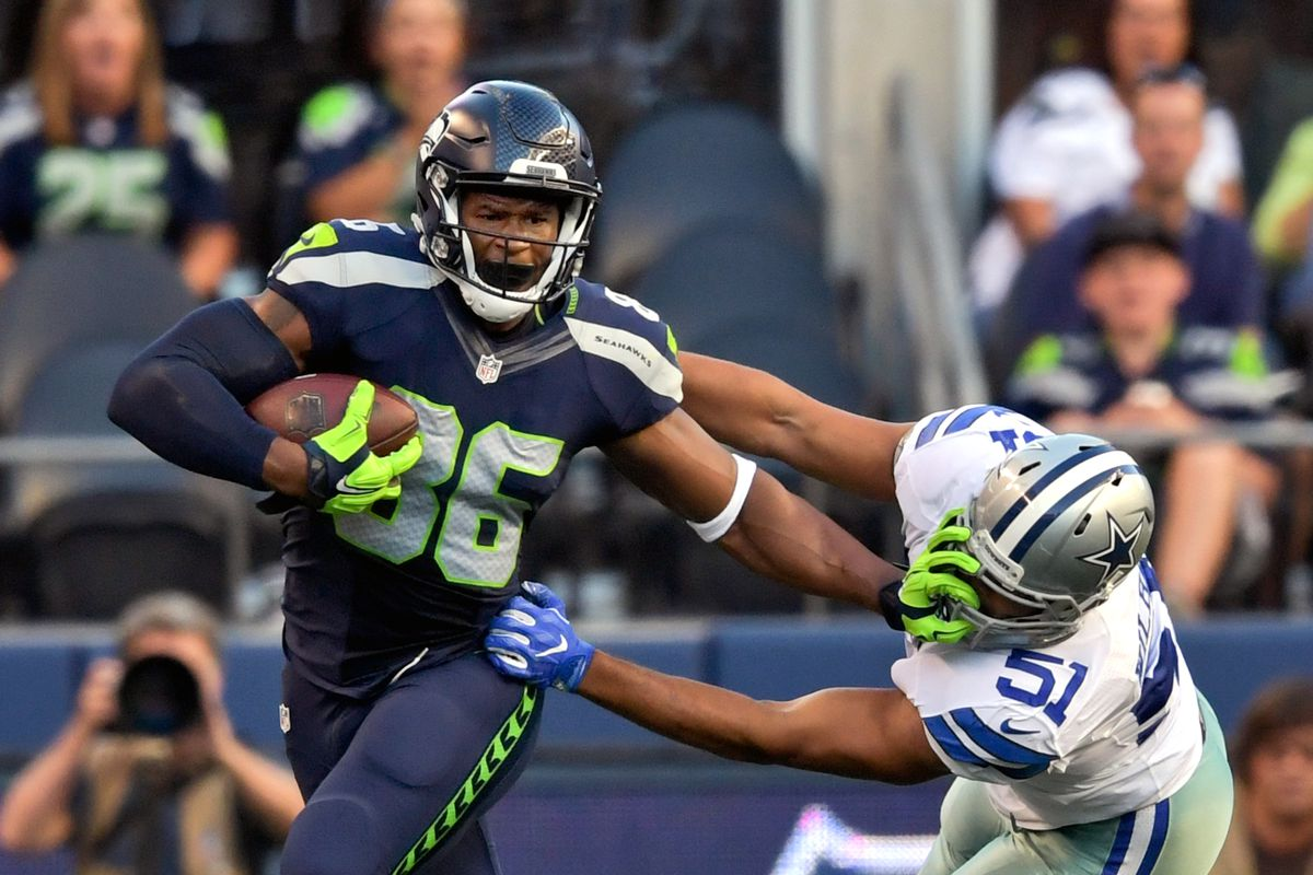 9b459b5c7 NFL: Preseason-Dallas Cowboys at Seattle Seahawks Grasping and turning the  face mask ...