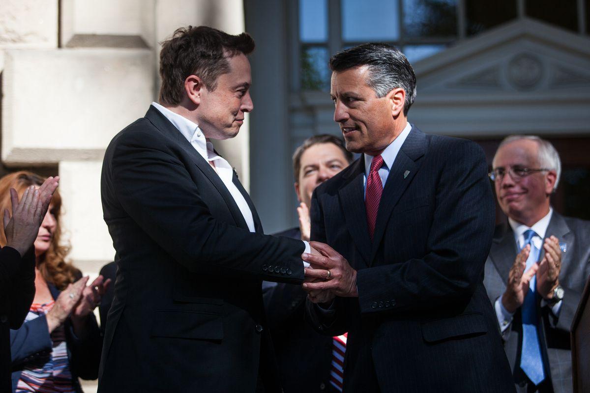 Brian Sandoval with Elon Musk.
