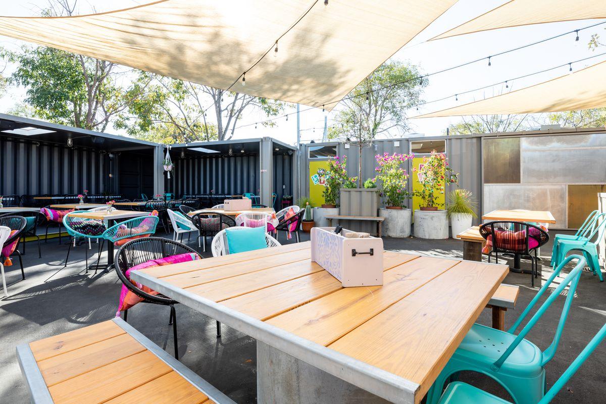 Seating and awning coverage at Nido's Backyard