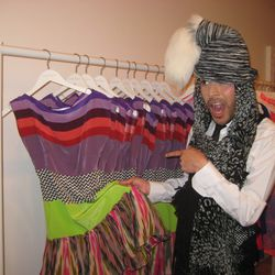 Mondo is excited to see his dresses for sale on the rack.