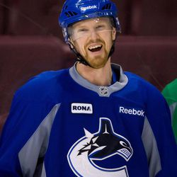 Vancouver Canucks' Henrik Sedin, of Sweden, laughs during hockey practice in Vancouver, British Columbia  on Tuesday April 10, 2012. The Vancouver Canucks and Los Angeles Kings are scheduled to play game 1 of an NHL Western Conference quarterfinal series Wednesday.