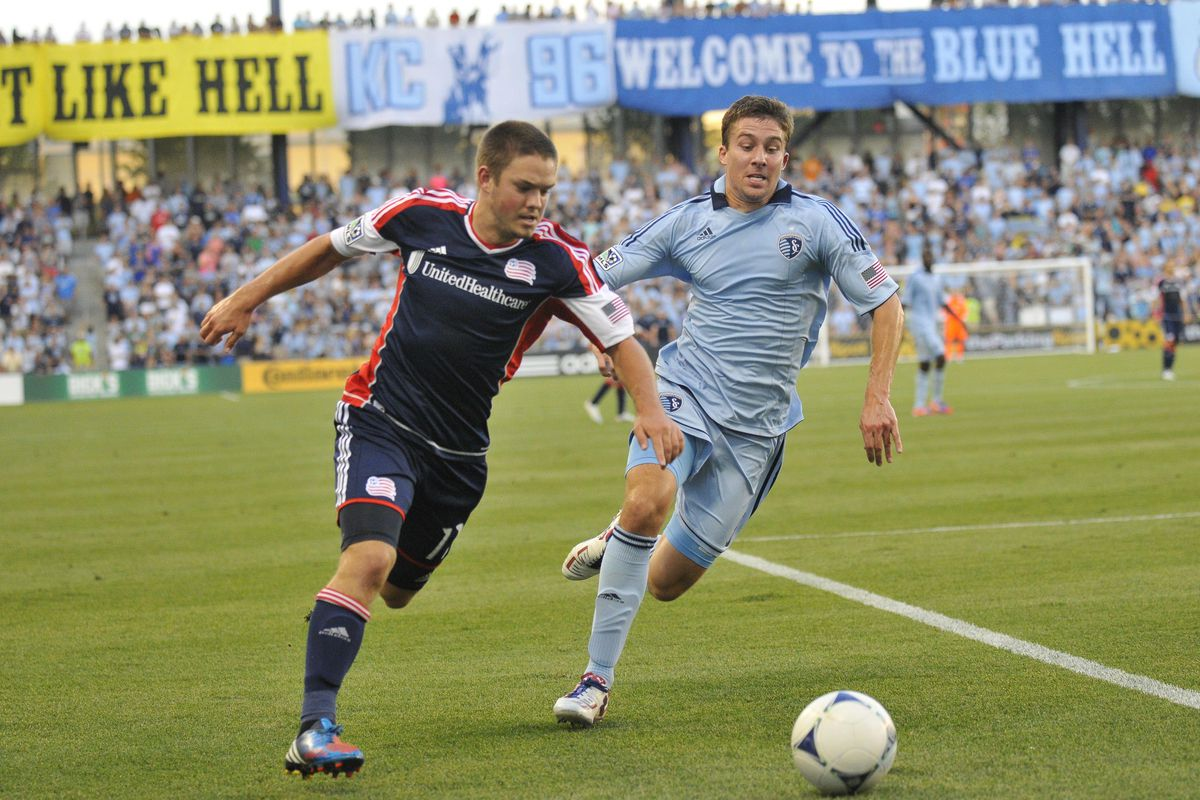 July 21, 2012; New England Revolution midfielder Kelyn Rowe (11) and Sporting KC defender Matt Besler (5) fight for the ball during the first half of the soccer match at LIVESTRONG Sporting Park.  Mandatory Credit: Denny Medley-US PRESSWIRE