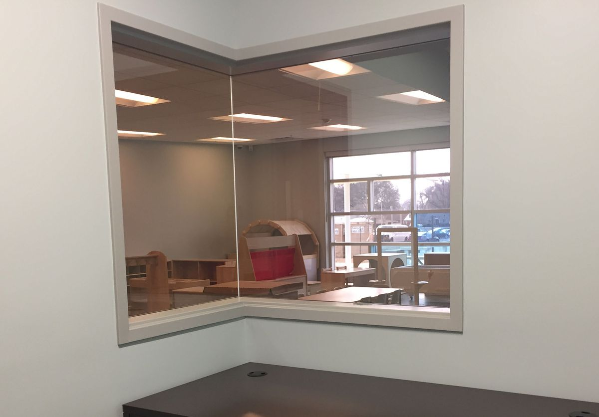 An observation room allows teachers in training to peek into a classroom.