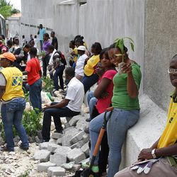 Haitian LDS Church members gather in an urban neighborhood for a church-sponsored tree planting project.