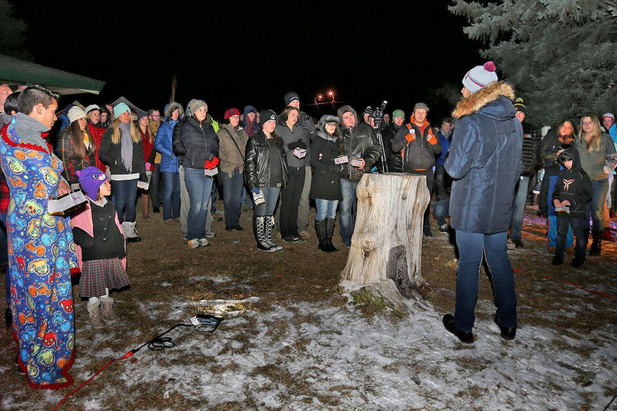 FILE  — People listen as Syrian refugee Qutaiba Idlbi talks about his journey to America as hundreds gather and prepare light lanterns in Sugarhouse Park as a gesture of compassion for the millions of displaced families and individuals both near and far.