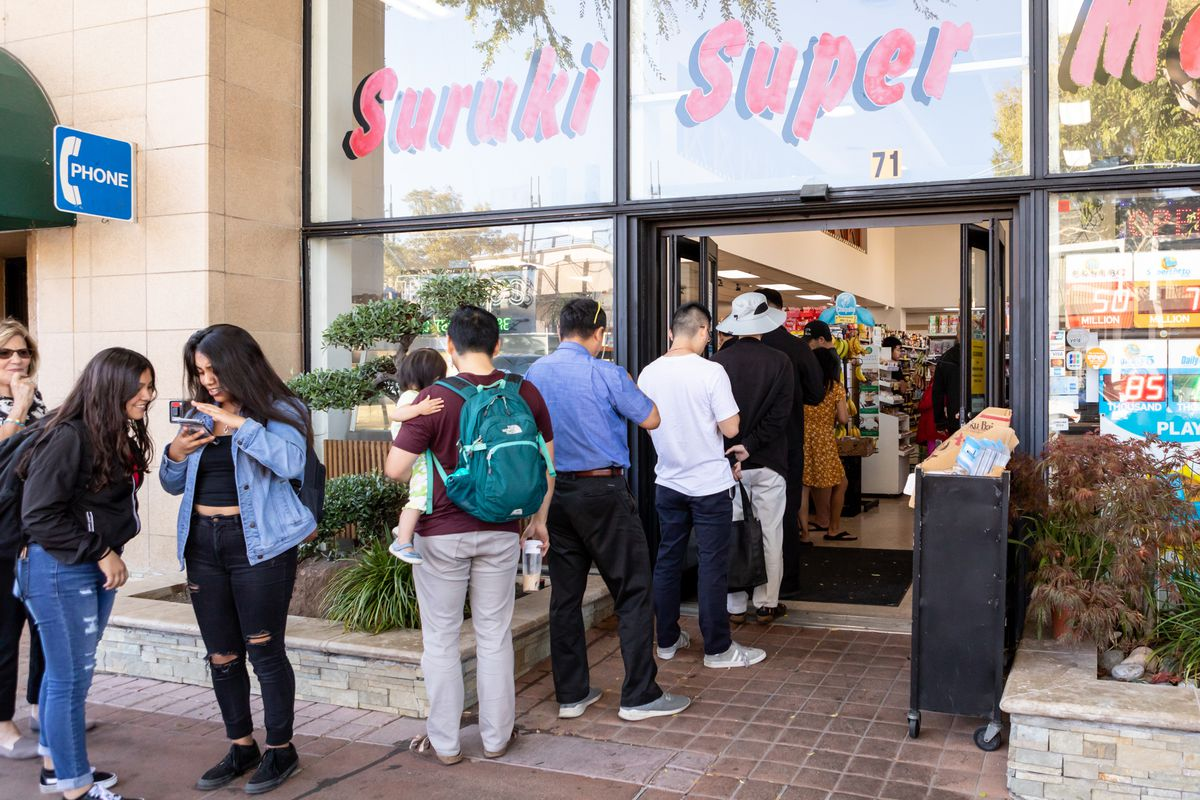 Customers line up outside Suruki Super Market