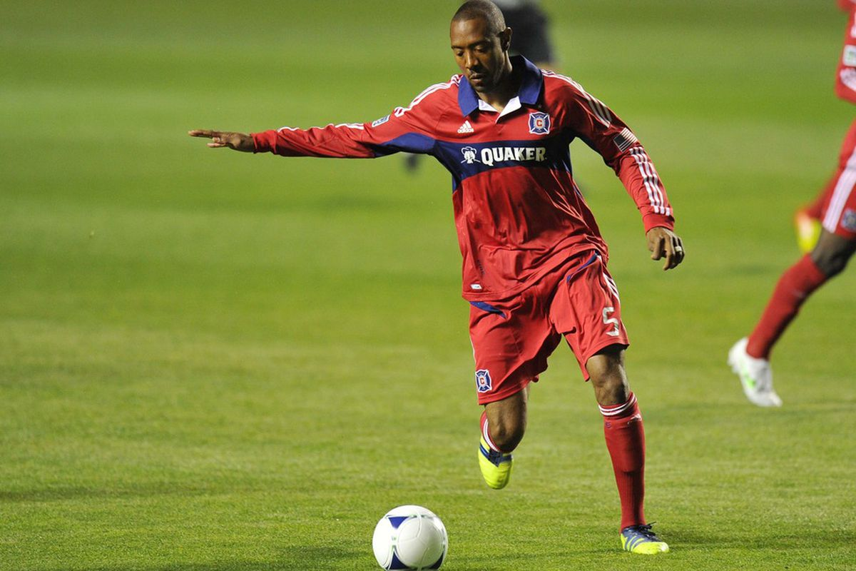 Mar 24, 2012; Bridgeview, IL, USA;  Chicago Fire defender Cory Gibbs (5) kicks the ball against the Philadelphia Union during the first half at Toyota Park.  Mandatory Credit: Mike DiNovo-US PRESSWIRE