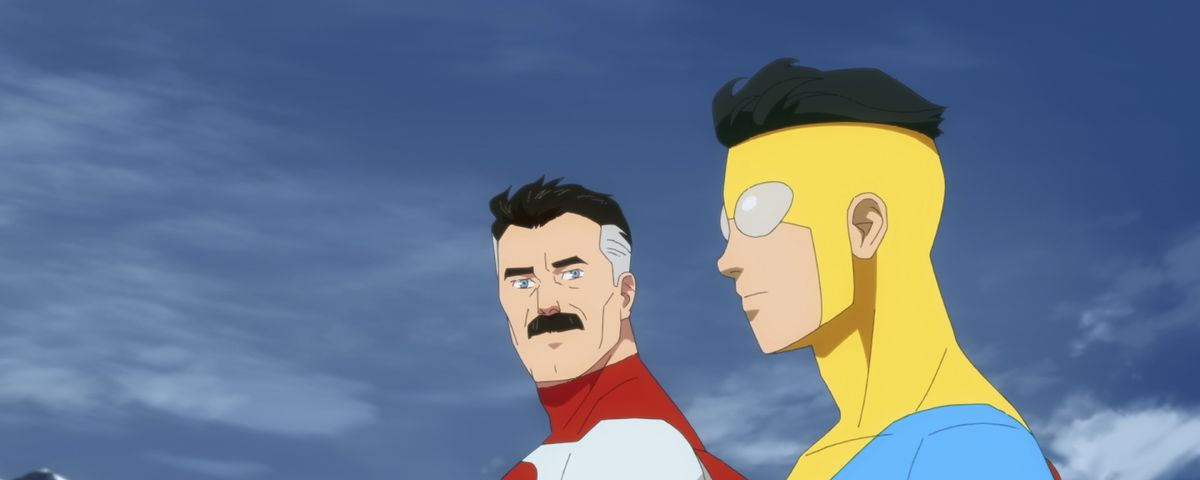 Omni-Man and his son Invincible side by side, in their superhero costumes