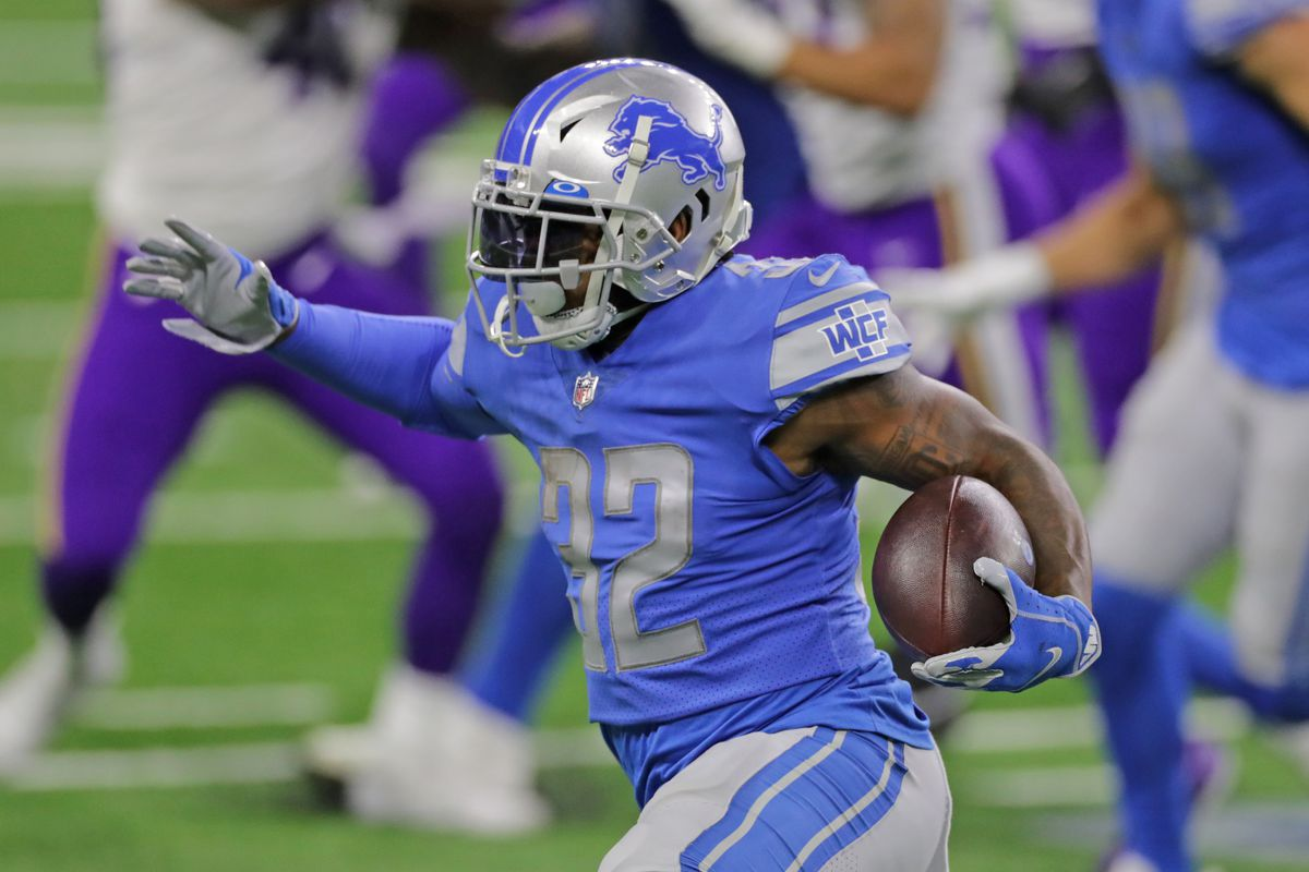 D'Andre Swift #32 of the Detroit Lions runs for a short gain during the fourth quarter of the game against the Minnesota Vikings at Ford Field on January 03, 2021 in Detroit, Michigan. Minnesota defeated Detroit 37-35.