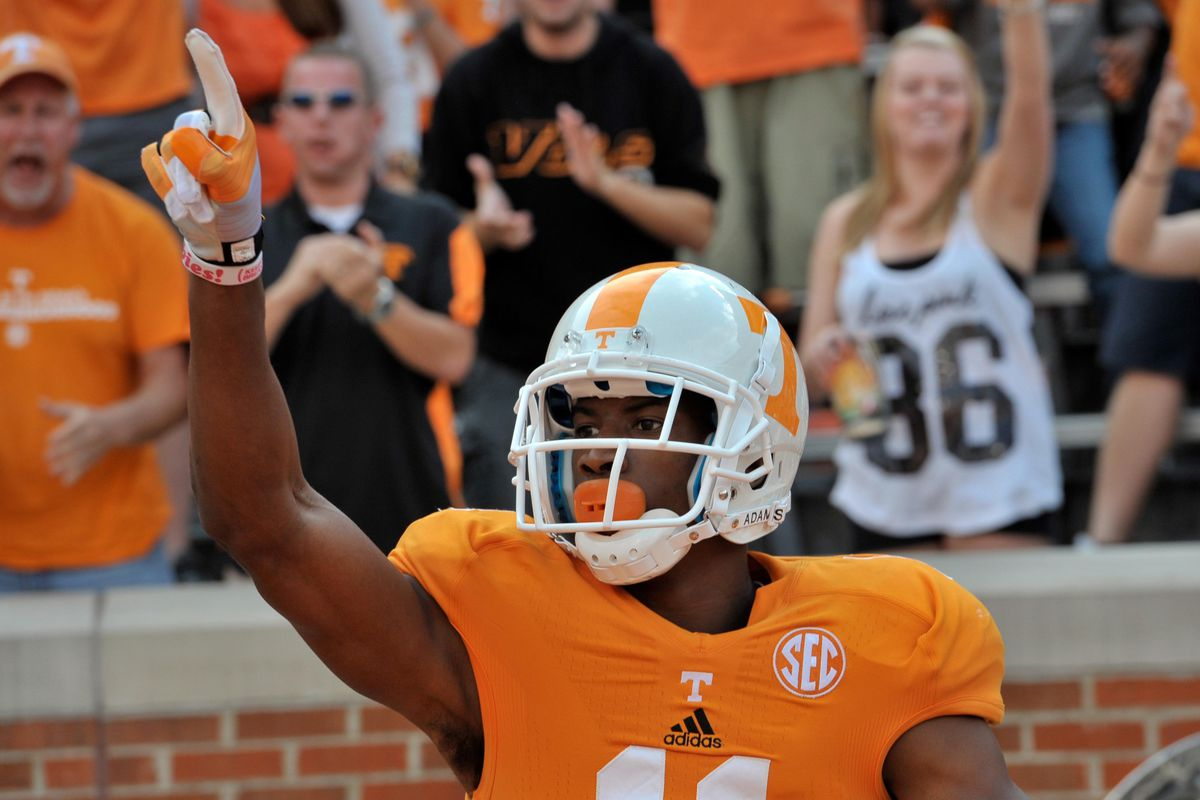 Sep 8, 2012; Knoxville, TN, USA;  Tennessee Volunteers wide receiver Justin Hunter (11) celebrates after scoring a touchdown against the Georgia State Panthers during the second quarter at Neyland Stadium. Mandatory Credit: Jim Brown-US PRESSWIRE