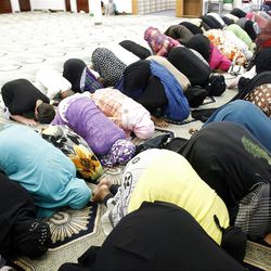 Women pray at the Khadeeja Islamic Center in West Valley City on Friday, June 29, 2012.
