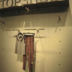 Sleeveless blouse, $52. Skinny plaid pants, $64.