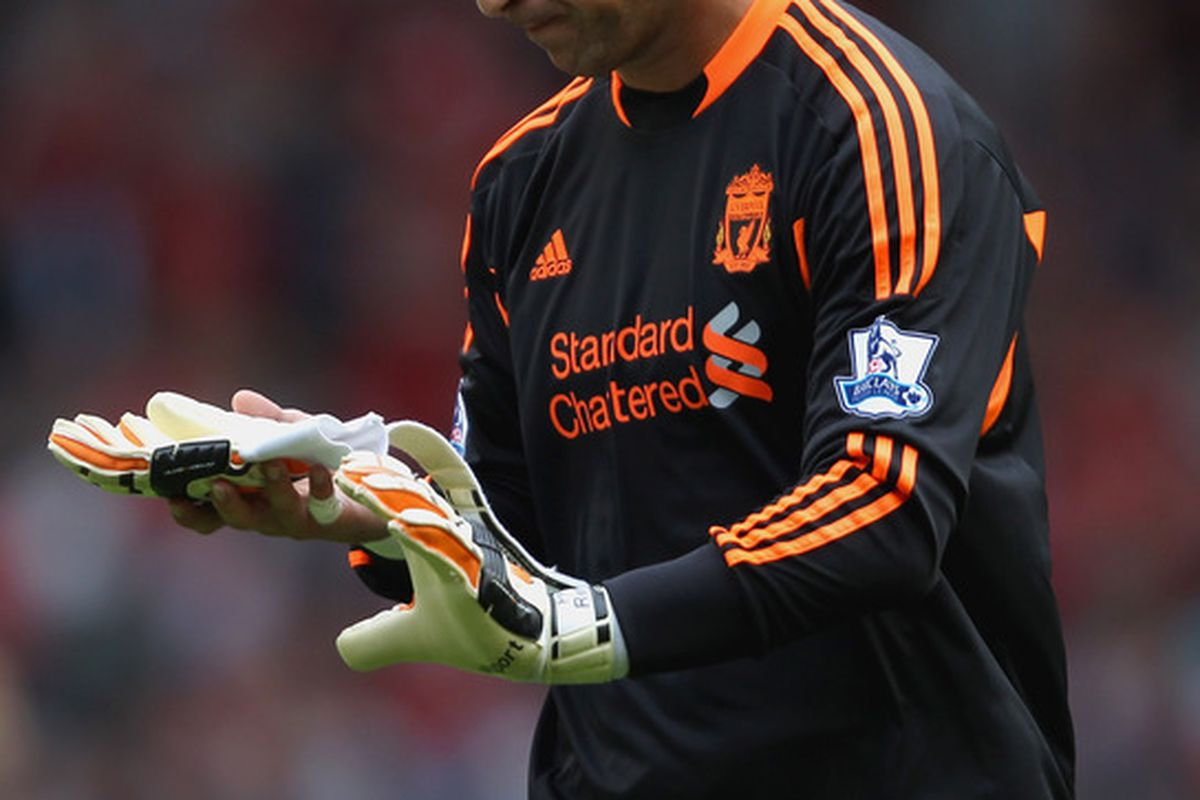 LIVERPOOL, ENGLAND - AUGUST 13:  Jose Reina of Liverpool looks dejected after the Barclays Premier League match between Liverpool and Sunderland at Anfield on August 13, 2011 in Liverpool, England.  (Photo by Clive Brunskill/Getty Images)