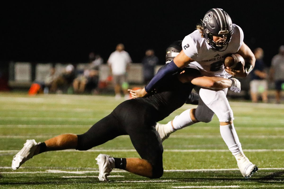 Corner Canyon's Jaxson Dart (2) carries the ball for a first down during a high school football game at Lone Peak High School in Highland on Thursday, Sept. 24, 2020.