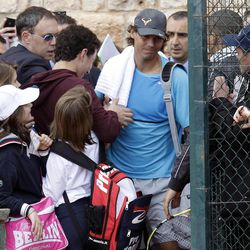Spanish player Rafael Nadal shakes hands of a supporter before a training session of the Monte Carlo Tennis Masters tournament in Monaco, Sunday, April 15, 2012.