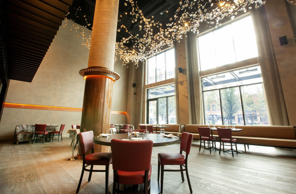 Nobu Chicago's dining room has earthy tones, and red leather seats.