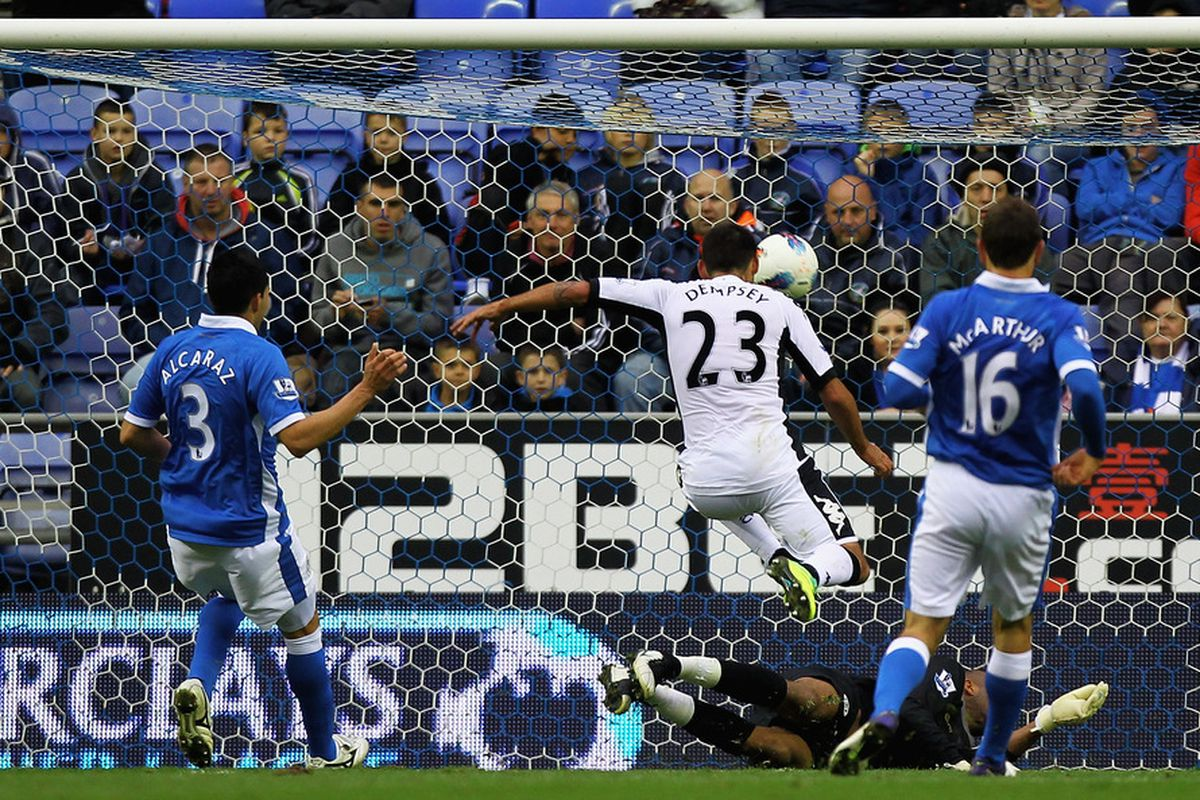 WIGAN, ENGLAND - OCTOBER 29:  Clint Dempsey of Fulham scores a goal during the Barclays Premier League match between Wigan Athletic and Fulham at DW Stadium on October 29, 2011 in Wigan, England.  (Photo by Matthew Lewis/Getty Images)