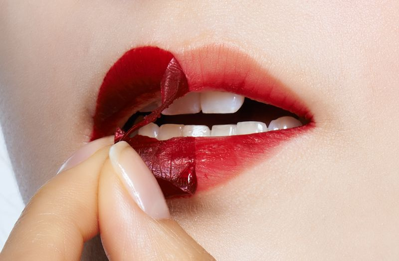 A woman demonstrates how to use the peel-off lip tint