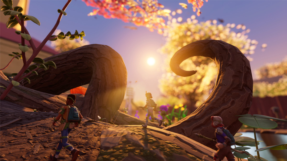 A party of players walks along a twisted root structure near sunset.