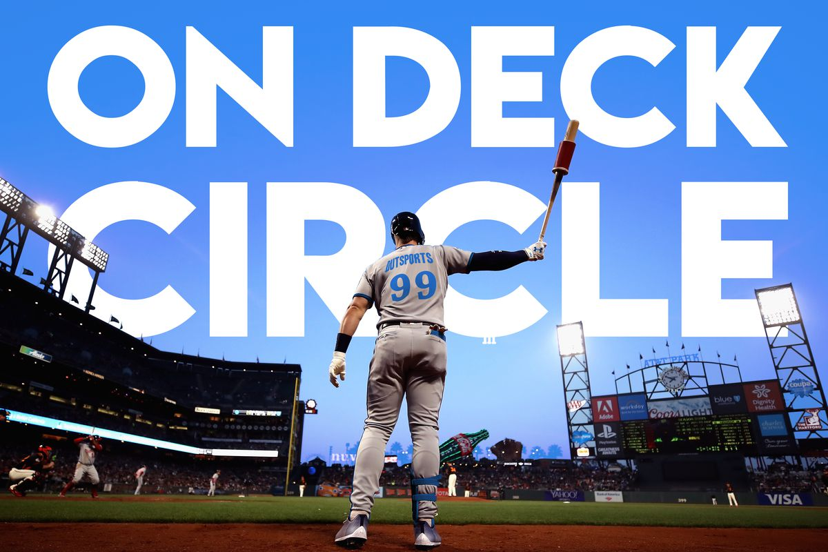 A baseball player stands in the on deck circle ready to face a pitcher in an MLB game at what was once known as AT&T Park in the San Francisco Bay Area.
