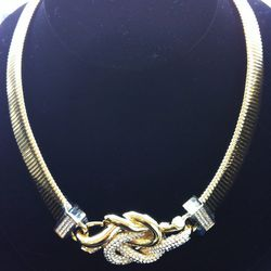 """""""This intertwined knot signifies eternity. It's a great piece to give to someone you love."""" Love Me Knots Collection necklace, $550"""