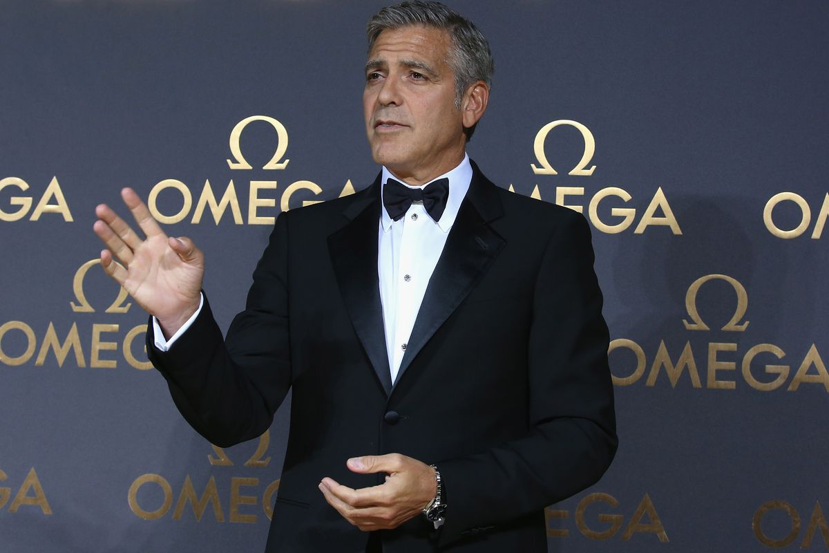 Actor George Clooney arrives for the red carpet of Omega Le Jardin Secret dinner party on May 16, 2014 in Shanghai, China.