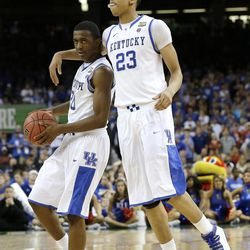 Kentucky's Doron Lamb, left, celebrates with teammate Anthony Davis at the end of the NCAA Final Four tournament college basketball championship game against Kansas Monday, April 2, 2012, in New Orleans. Kentucky won 67-59.