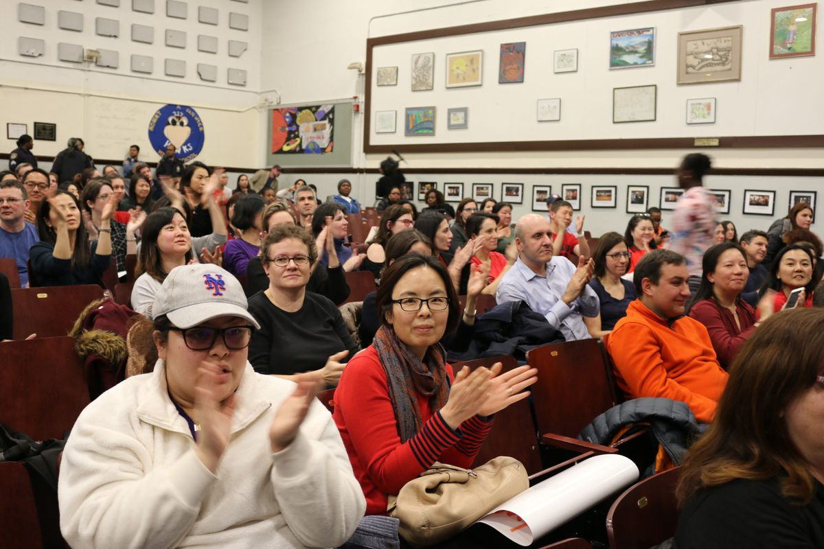 Parents in January 2020 applaud a speaker during a contentious meeting to discuss middle school integration plans for District 28 in Queens. Fights how to make New York City schools more representative of student demographics have filtered down to the races to elect Community Education Council members.