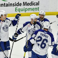 Syracuse Crunch players congratulate Cory Conacher (89) for his goal against the Utica Comets in American Hockey League (AHL) action in the Adirondack Bank Center at the Utica Memorial Auditorium in Utica, New York on Friday, November 16, 2018. Syracuse won 4-0.