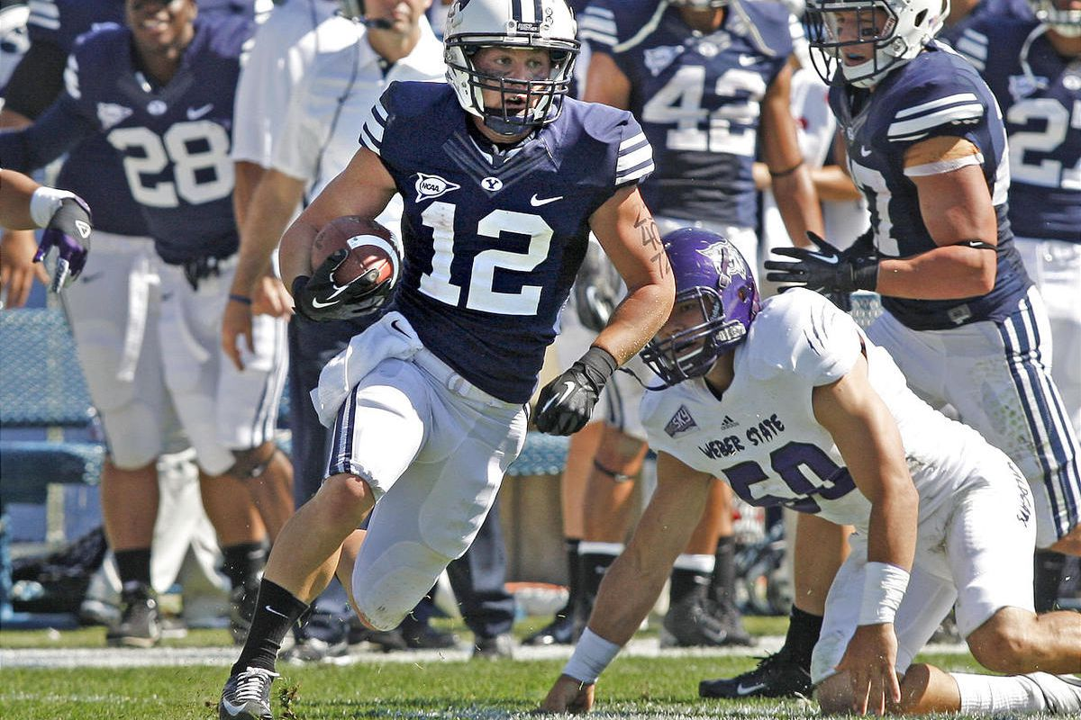 Brigham Young wide receiver JD Falslev (12) runs after a catch during the Cougars 45-13 defeat over the  Weber State Wildcats.
