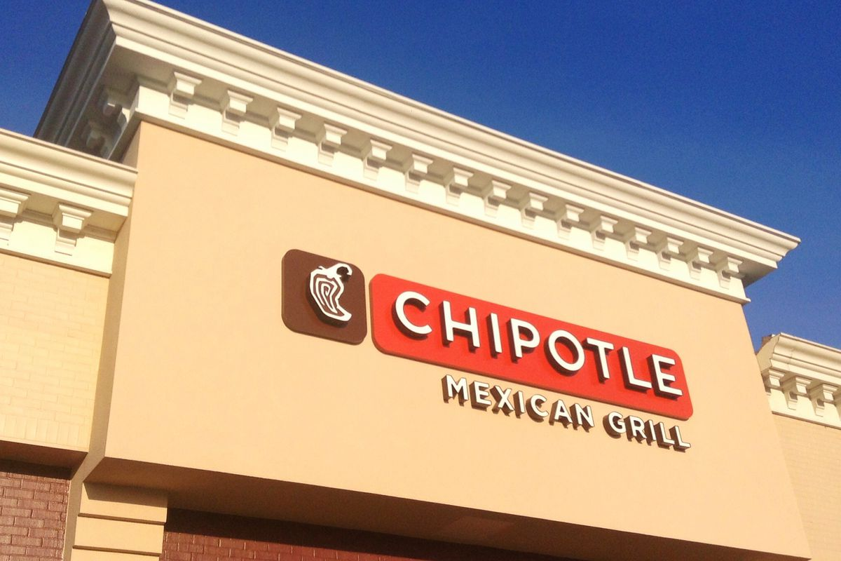 A beige building exterior with a red Chipotle sign