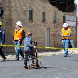Korbinn Bolen, 5, watches as officials assess the damage to Colosimo's in Magna following a 5.7 magnitude earthquakeon Wednesday, March 18, 2020.