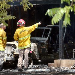 Investigators work in and around the scene of a fire at 3381 S. 3170 East in Millcreek on Sunday, July 5, 2020.