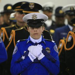 Transportation Security Administration honor guard Brandy Richards, center, carries the U.S. honor flag during the public memorial service for slain TSA officer Gerardo Hernandez, Tuesday, Nov. 12, 2013, in Los Angeles. Hernandez was the first TSA officer killed in the line of duty when a gunman pulled a rifle from a bag and shot the 39-year-old father of two on Nov. 1, at Los Angeles International Airport. Two TSA officers and a teacher were injured before airport police wounded the gunman, Paul Ciancia.